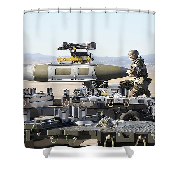 Irman Assists In Lowering A Guided Bomb Shower Curtain by Stocktrek Images