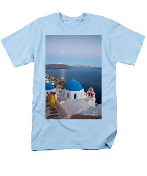 Moon over blue domed church in Oia Santorini Greece T-Shirt by Matteo Colombo