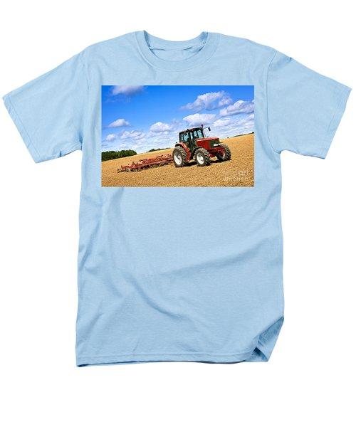 Tractor in plowed farm field T-Shirt by Elena Elisseeva