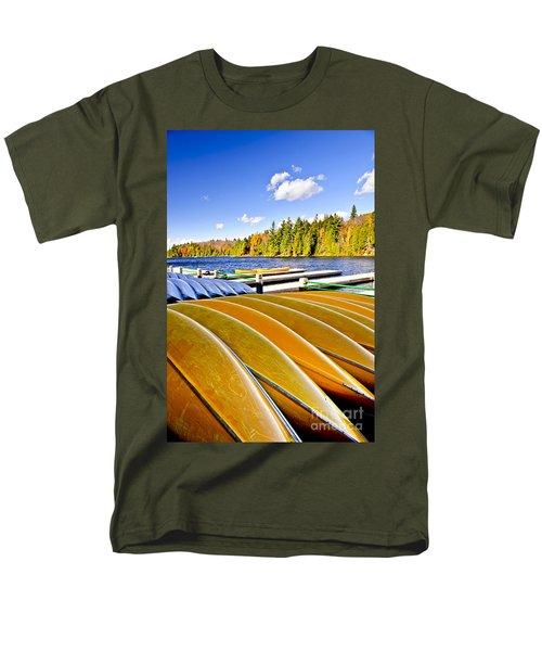 Canoes on autumn lake T-Shirt by Elena Elisseeva