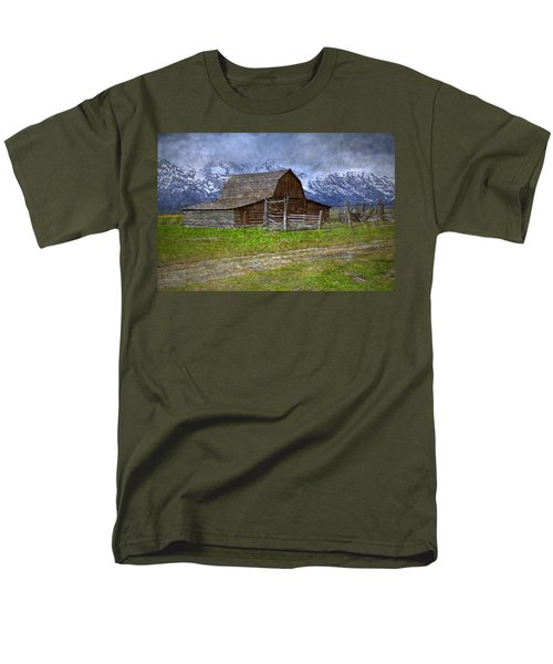 Grand Teton Iconic Mormon Barn Fence Spring Storm Clouds T-Shirt by John Stephens
