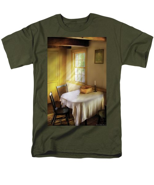 Kitchen - The empty basket T-Shirt by Mike Savad