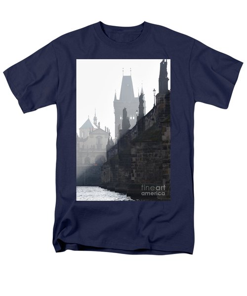 Charles bridge in the early morning fog T-Shirt by Michal Boubin