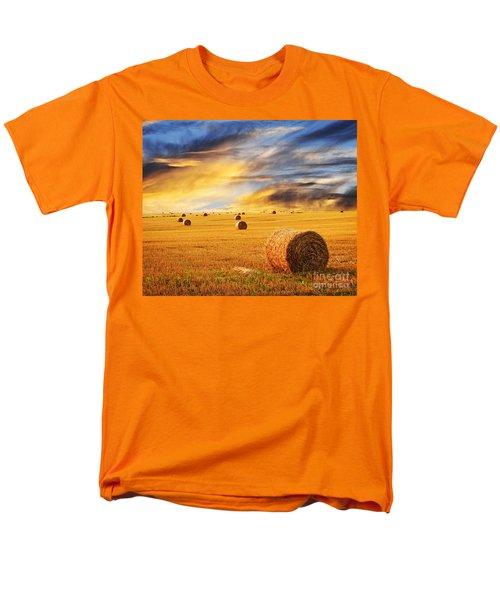 Golden sunset over farm field with hay bales T-Shirt by Elena Elisseeva