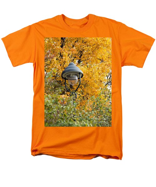 lamp in the autumn leaves T-Shirt by Michal Boubin