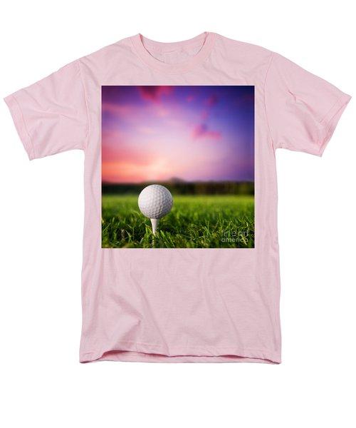 Golf ball on tee at sunset T-Shirt by Michal Bednarek