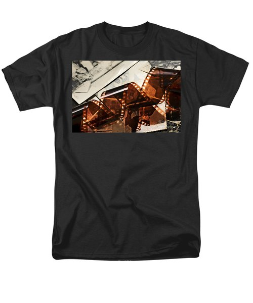 Old film strip and photos background T-Shirt by Michal Bednarek