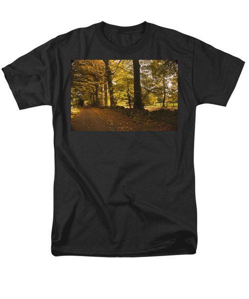 Tree Lined Road Covered With Fallen T-Shirt by John Short