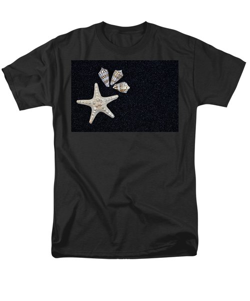 starfish on black sand T-Shirt by Joana Kruse