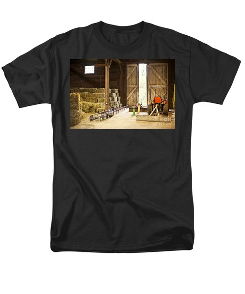 Barn with hay bales and farm equipment T-Shirt by Elena Elisseeva