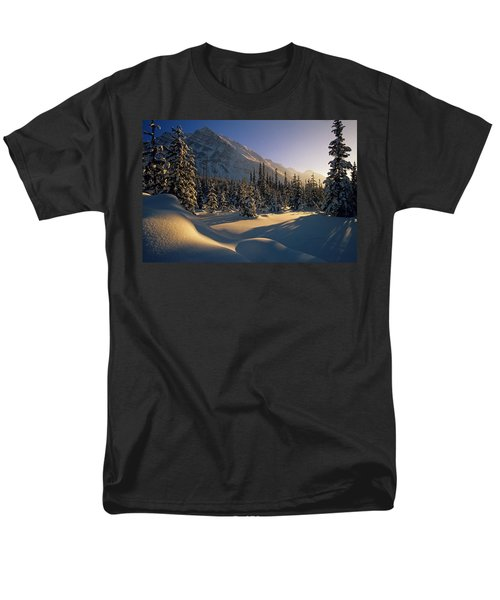Sun Setting Behind Trees And Mountain T-Shirt by Mike Grandmailson