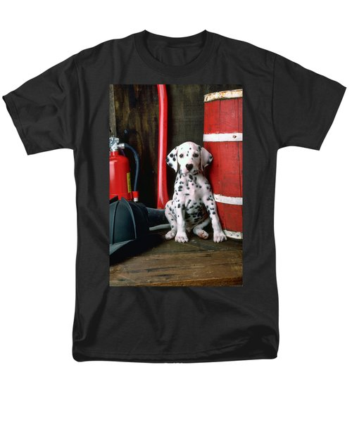 Dalmatian puppy with fireman's helmet  T-Shirt by Garry Gay