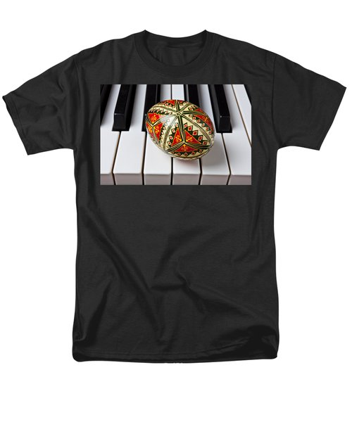 Painted Easter egg on piano keys T-Shirt by Garry Gay