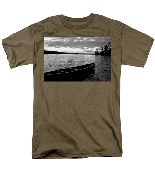 Abandoned Canoe Floating On Water T-Shirt by Keith Levit