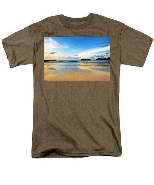 dramatic scene of sunset on the beach T-Shirt by Setsiri Silapasuwanchai