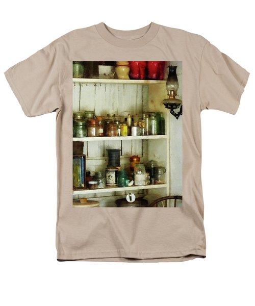 Hurricane Lamp in Pantry T-Shirt by Susan Savad