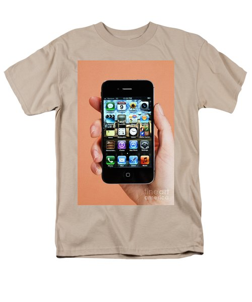 Hand Holding An Iphone T-Shirt by Photo Researchers