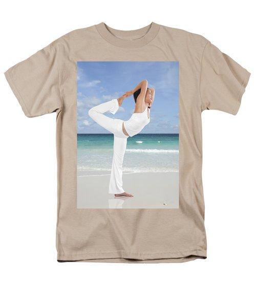 Woman doing yoga on the beach T-Shirt by Setsiri Silapasuwanchai