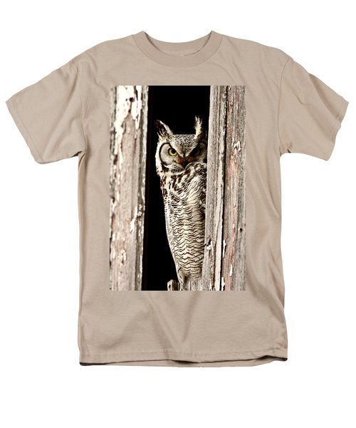 Great Horned Owl perched in barn window T-Shirt by Mark Duffy