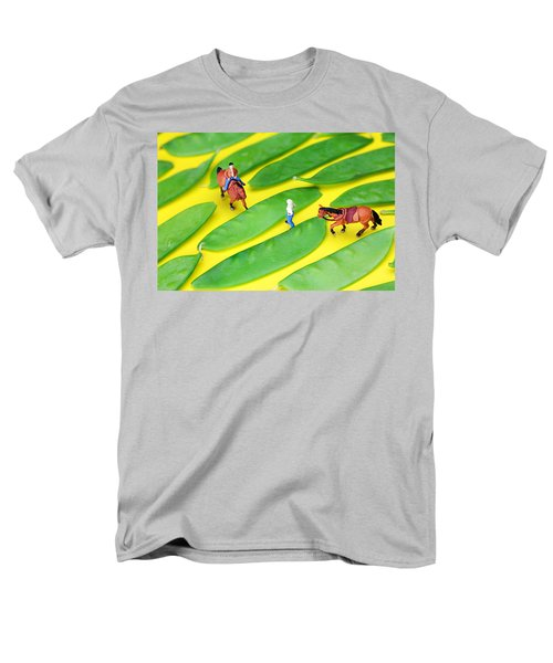 Horse riding on snow peas little people on food T-Shirt by Paul Ge