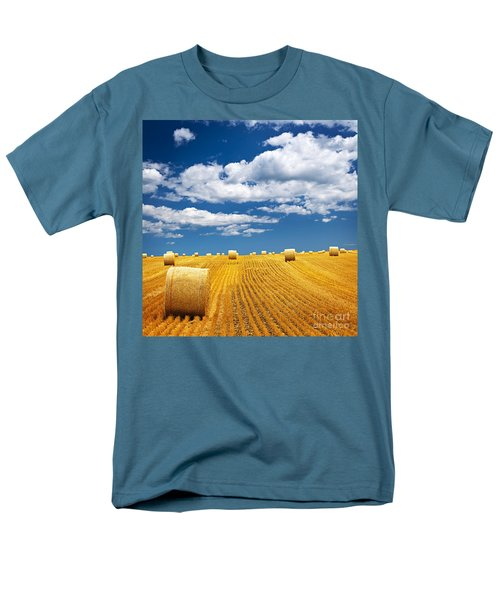 Farm field with hay bales T-Shirt by Elena Elisseeva