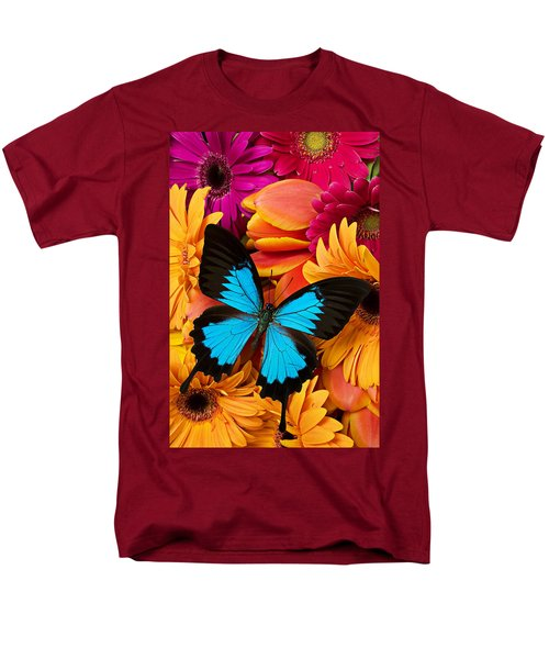 Blue butterfly on brightly colored flowers T-Shirt by Garry Gay