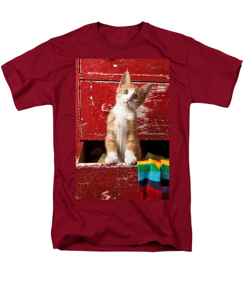 Orange tabby kitten in red drawer  T-Shirt by Garry Gay