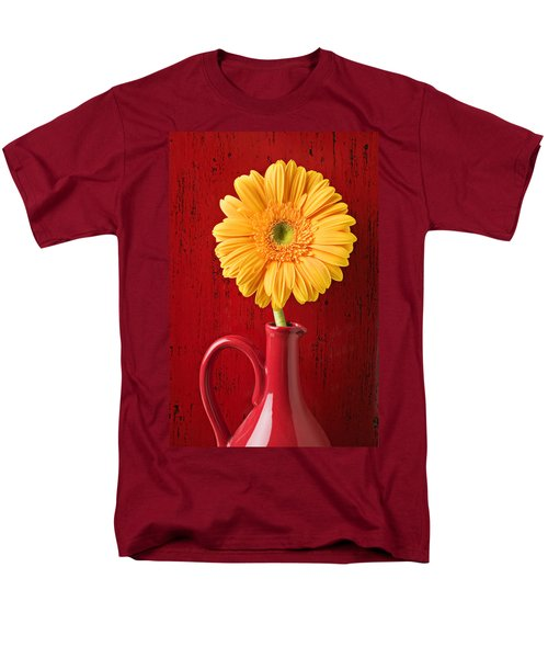Yellow daisy in red vase T-Shirt by Garry Gay