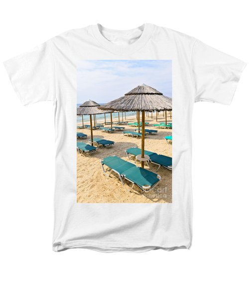 Beach umbrellas on sandy seashore T-Shirt by Elena Elisseeva