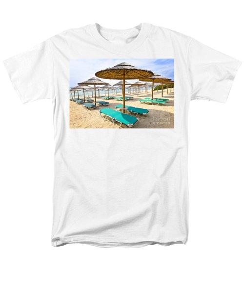 Beach umbrellas on sandy seashore T-Shirt by Elena Elisseeva