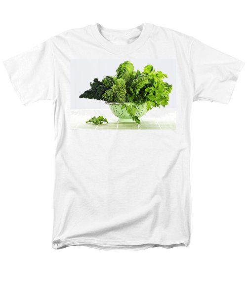 Dark green leafy vegetables in colander T-Shirt by Elena Elisseeva