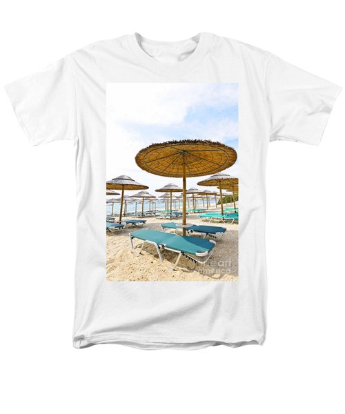 Beach umbrellas and chairs on sandy seashore T-Shirt by Elena Elisseeva
