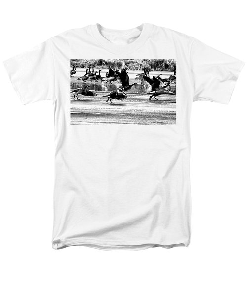 Geese on Ice Taking Flight T-Shirt by Bill Cannon