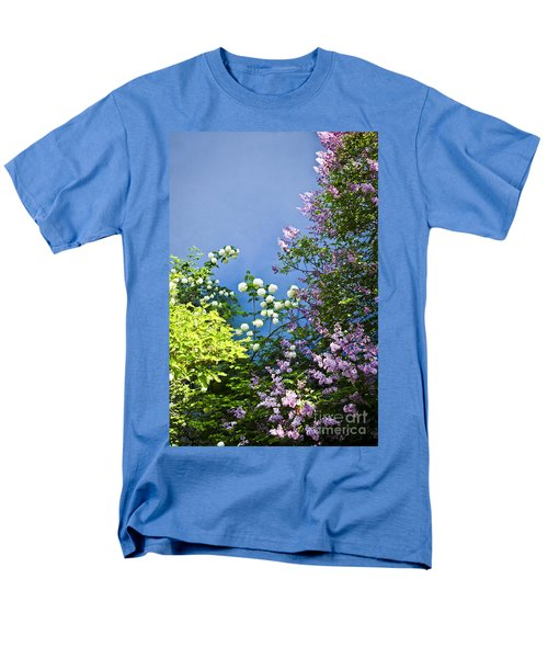 Blue wall with flowers T-Shirt by Elena Elisseeva