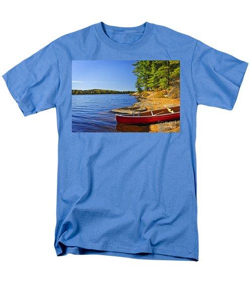 Canoe on shore T-Shirt by Elena Elisseeva