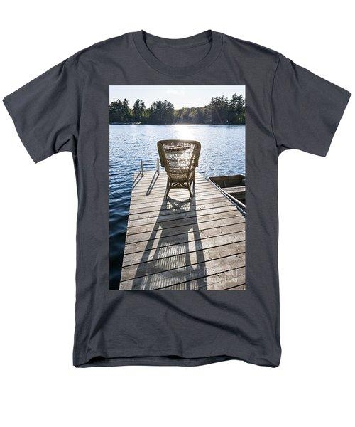 Rocking chair on dock T-Shirt by Elena Elisseeva