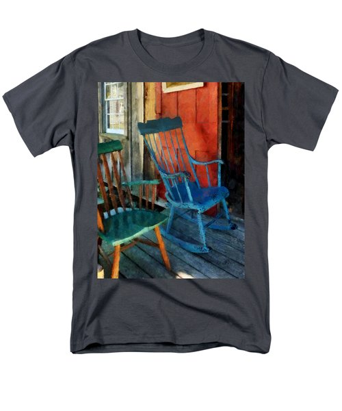 Blue Chair Against Red Door T-Shirt by Susan Savad