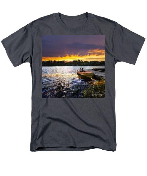 Boat on lake at sunset T-Shirt by Elena Elisseeva