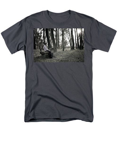 Girl sitting on a wooden bench in the forest against the light T-Shirt by Joana Kruse