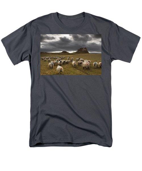 Sheep Grazing By Lindisfarne Castle T-Shirt by John Short