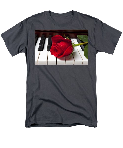 Red rose on piano keys T-Shirt by Garry Gay