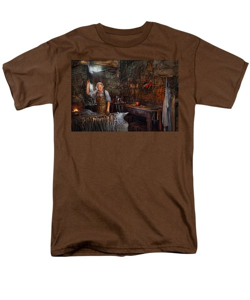 Blacksmith - Working the forge  T-Shirt by Mike Savad