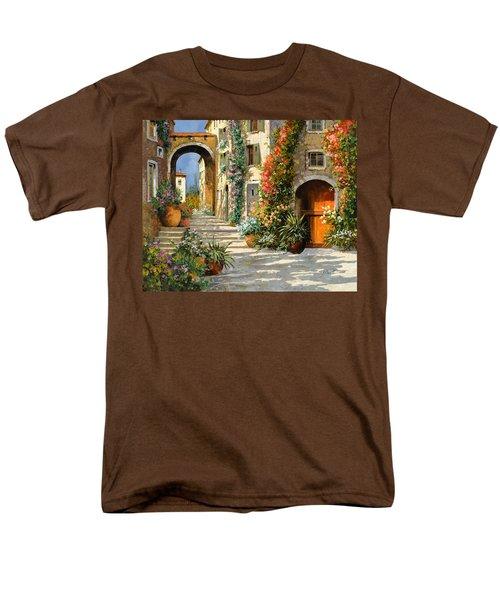 la porta rossa sulla salita T-Shirt by Guido Borelli