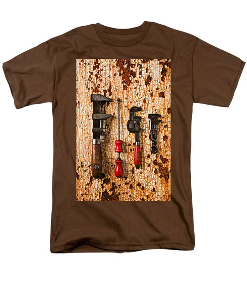 Old tools on rusty counter  T-Shirt by Garry Gay