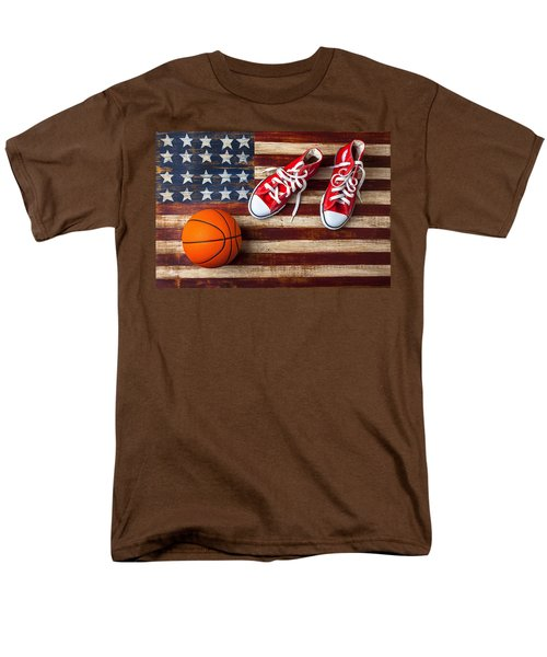 Tennis shoes and basketball on flag T-Shirt by Garry Gay
