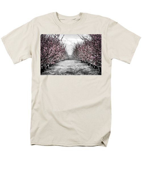 Blooming peach orchard T-Shirt by Elena Elisseeva