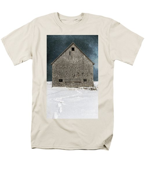 Old barn in a snow storm T-Shirt by Edward Fielding