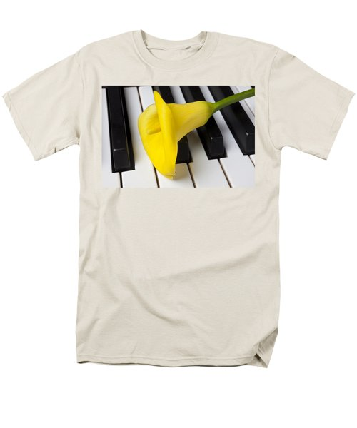 Calla lily on keyboard T-Shirt by Garry Gay