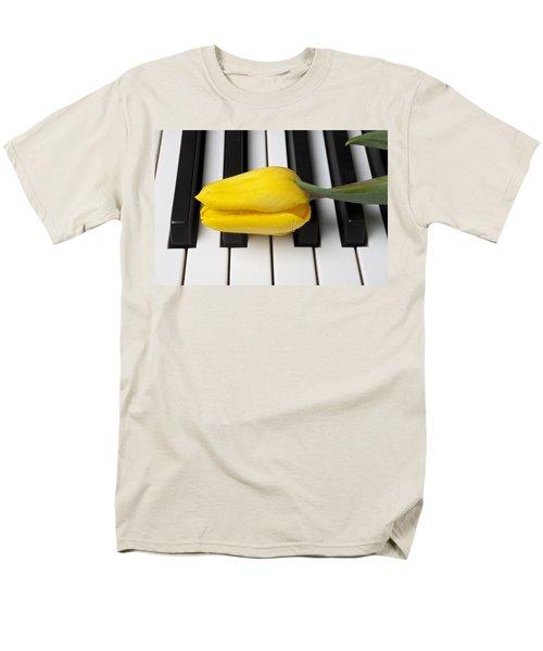 Yellow tulip on piano keys T-Shirt by Garry Gay