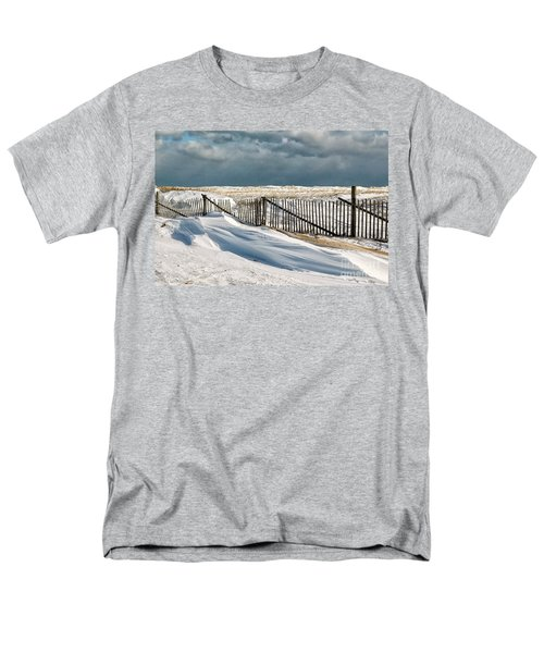 Drifting snow along the beach fences at Nauset Beach in Orleans  T-Shirt by Matt Suess